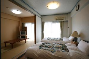 Garland Court Usami Private Hot Spring Condominium Hotel, Apartmanhotelek  Ito - big - 19