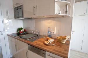 Premium Appartement Rosenmöwe Sylt, Apartmanok  Wenningstedt - big - 19