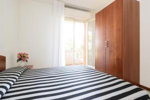 Residence Shakespeare, Apartmány  Lignano Sabbiadoro - big - 9