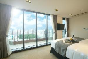 Benikea I-Jin Hotel, Hotely  Jeju - big - 27