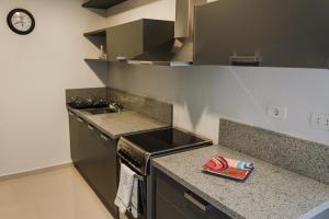 Realty PY Saravi, Apartmanok  Asuncion - big - 9