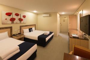 Pokoj typu Superior s manželskou postelí velikosti Queen (3 dospělí)