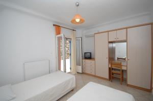 Asimina, Guest houses  Tourlos - big - 11