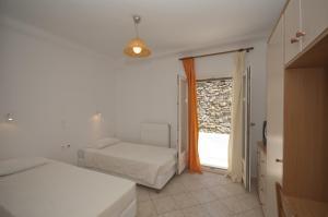 Asimina, Guest houses  Tourlos - big - 2