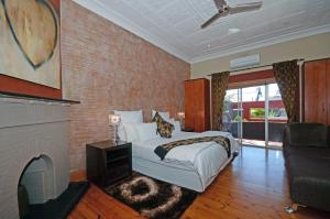 Улучшенный двухместный номер с 1 кроватью или 2 отдельными кроватями