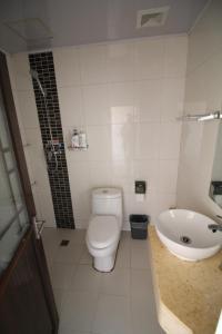 Habitación Doble con 2 camas y baño privado