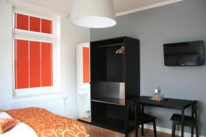 Apartmenthaus Unterwegs, Guest houses  Rostock - big - 14