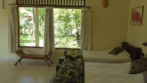 Rumah Kita Guesthouse, Vendégházak  Kalibaru - big - 18