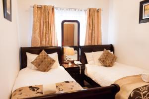 Zweibettzimmer mit Gemeinschaftsbad