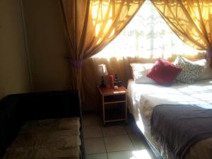 Nzipile Executive Guest House, Bed and breakfasts  Chingola - big - 13
