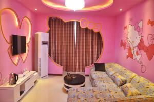 Huazhong Theme Apartment Hotel