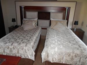 Pokój typu Standard z łóżkiem typu king-size lub 2 łóżkami pojedynczymi