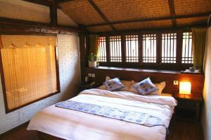 Lijiang Shuhe Qingtao Inn, Penziony  Lijiang - big - 12