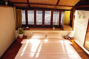 Lijiang Shuhe Qingtao Inn, Guest houses  Lijiang - big - 14