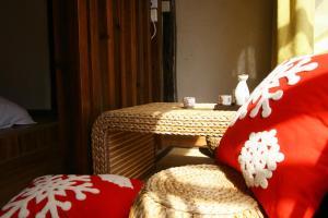 Lijiang Shuhe Qingtao Inn, Penziony  Lijiang - big - 16
