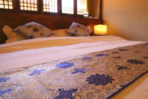 Lijiang Shuhe Qingtao Inn, Penziony  Lijiang - big - 19