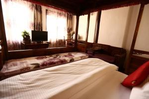 Lijiang Jinsheng Youyue Inn, Гостевые дома  Лицзян - big - 9
