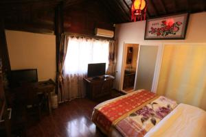 Lijiang Jinsheng Youyue Inn, Гостевые дома  Лицзян - big - 58