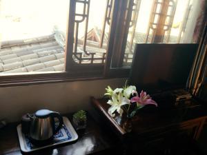 Lijiang Jinsheng Youyue Inn, Гостевые дома  Лицзян - big - 57