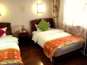 Lijiang Jinsheng Youyue Inn, Гостевые дома  Лицзян - big - 56