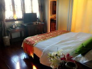 Lijiang Jinsheng Youyue Inn, Гостевые дома  Лицзян - big - 7