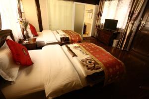 Lijiang Jinsheng Youyue Inn, Гостевые дома  Лицзян - big - 52