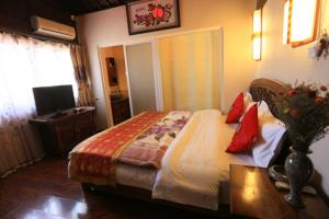 Lijiang Jinsheng Youyue Inn, Гостевые дома  Лицзян - big - 51