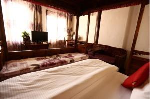 Lijiang Jinsheng Youyue Inn, Гостевые дома  Лицзян - big - 50