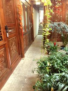 Lijiang Jinsheng Youyue Inn, Гостевые дома  Лицзян - big - 67