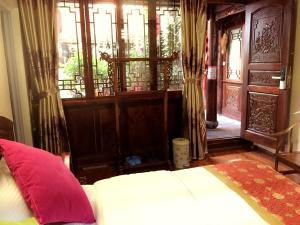 Lijiang Jinsheng Youyue Inn, Гостевые дома  Лицзян - big - 49