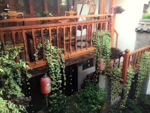 Lijiang Jinsheng Youyue Inn, Гостевые дома  Лицзян - big - 65