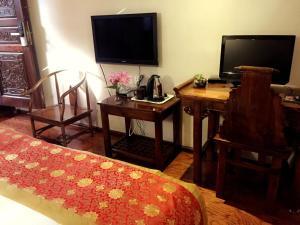 Lijiang Jinsheng Youyue Inn, Гостевые дома  Лицзян - big - 13
