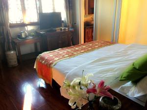 Lijiang Jinsheng Youyue Inn, Гостевые дома  Лицзян - big - 11