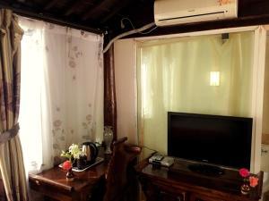 Lijiang Jinsheng Youyue Inn, Гостевые дома  Лицзян - big - 44