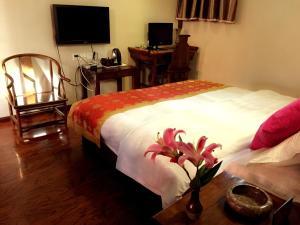 Lijiang Jinsheng Youyue Inn, Гостевые дома  Лицзян - big - 53