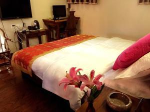Lijiang Jinsheng Youyue Inn, Гостевые дома  Лицзян - big - 19