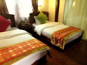 Lijiang Jinsheng Youyue Inn, Гостевые дома  Лицзян - big - 18
