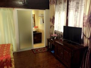 Lijiang Jinsheng Youyue Inn, Гостевые дома  Лицзян - big - 17