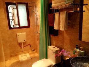 Lijiang Jinsheng Youyue Inn, Гостевые дома  Лицзян - big - 41