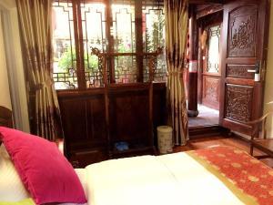 Lijiang Jinsheng Youyue Inn, Гостевые дома  Лицзян - big - 36