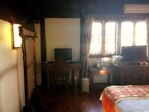 Lijiang Jinsheng Youyue Inn, Гостевые дома  Лицзян - big - 31