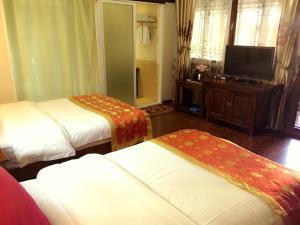 Lijiang Jinsheng Youyue Inn, Гостевые дома  Лицзян - big - 27
