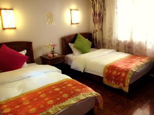 Lijiang Jinsheng Youyue Inn, Гостевые дома  Лицзян - big - 24