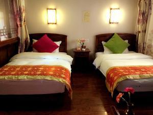 Lijiang Jinsheng Youyue Inn, Гостевые дома  Лицзян - big - 4