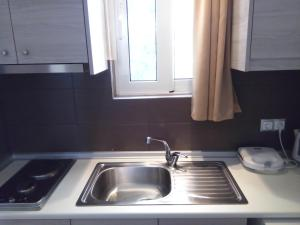 Karavos Hotel Apartments, Aparthotels  Archangelos - big - 10
