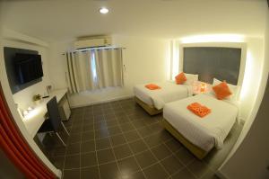 The Original Orange Hotel, Отели  Накхонситхаммарат - big - 40