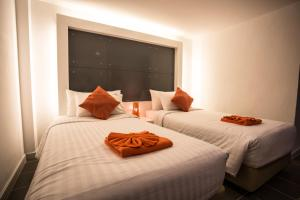 The Original Orange Hotel, Отели  Накхонситхаммарат - big - 20