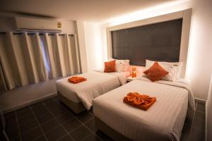 The Original Orange Hotel, Отели  Накхонситхаммарат - big - 18