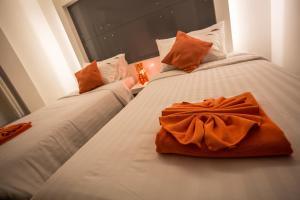 The Original Orange Hotel, Отели  Накхонситхаммарат - big - 15