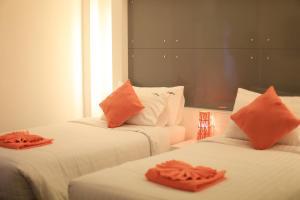 The Original Orange Hotel, Отели  Накхонситхаммарат - big - 14